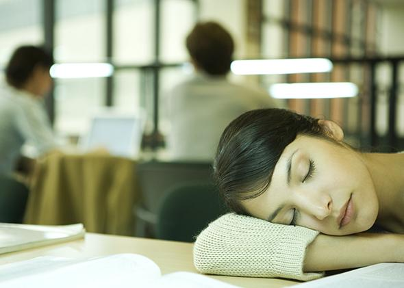 Female college student napping, not entertained