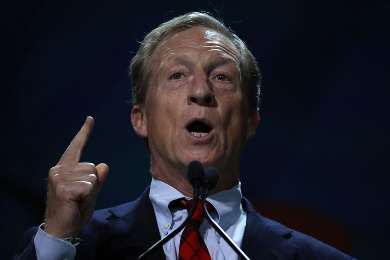 Steyer gestures forcefully while seen in close-up.