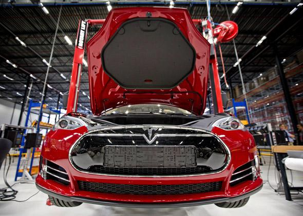 A view of a fully electric Tesla car on an assembly line at the new Tesla Motors car factory in Tilburg, the Netherlands, during the opening and launch of the new factory, on August 22, 2013.