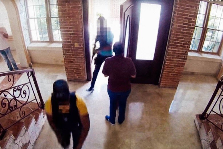 A housekeeper opens the door to a house as local authorities enter with guns and bulletproof vests.
