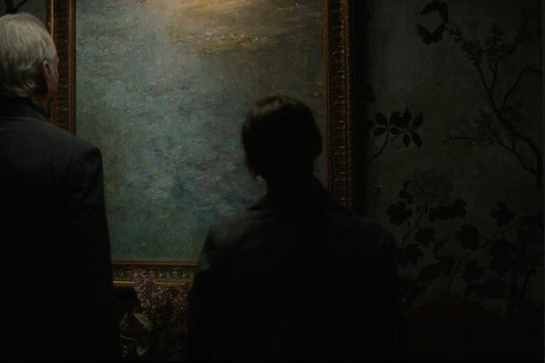 Bill Murray and Rashida Jones stand in front of and contemplate a Monet painting