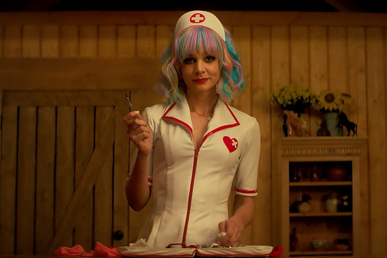 Carey Mulligan in a nurse's outfit with a tray of tools.