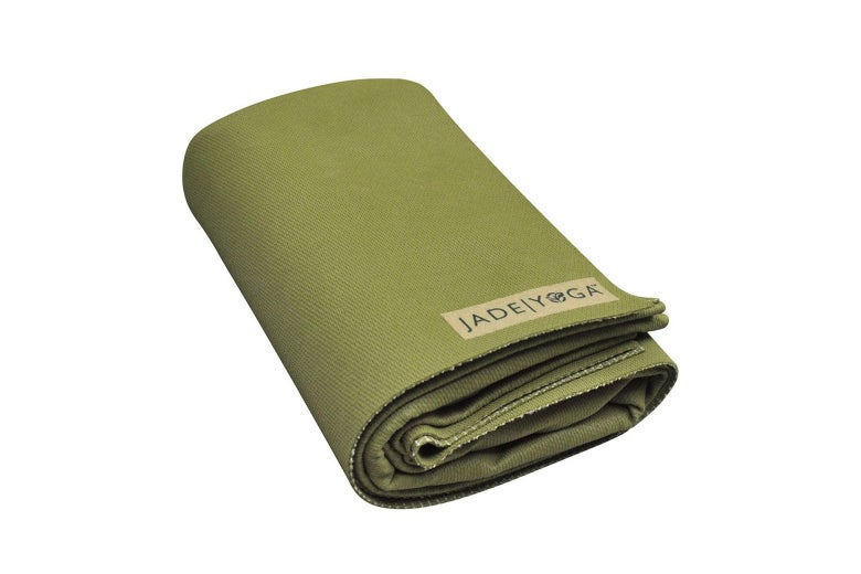 Green yoga mat folded up.