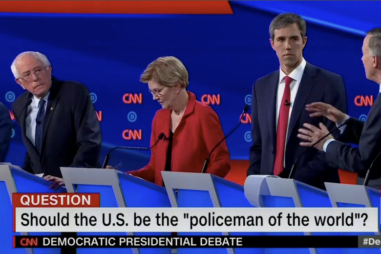 "Bernie Sanders, Elizabeth Warren, and Beto O'Rourke are shown in this screengrab from CNN. The banner reads: ""Should the U.S. be the 'policeman of the world'?"""