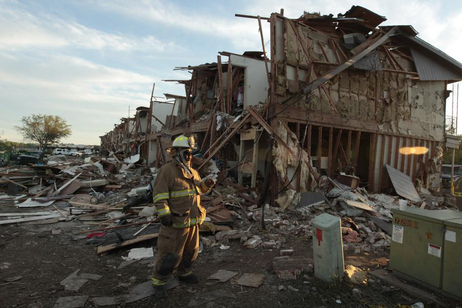 A Valley Mills Fire Department personnel walks among the remains of an apartment complex next to the fertilizer plant that exploded yesterday afternoon on April 18, 2013 in West, Texas.