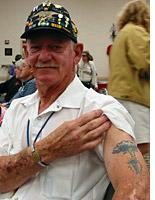 Jerry LeDoux showing off his lightning-strike tattoo         Click image to expand.