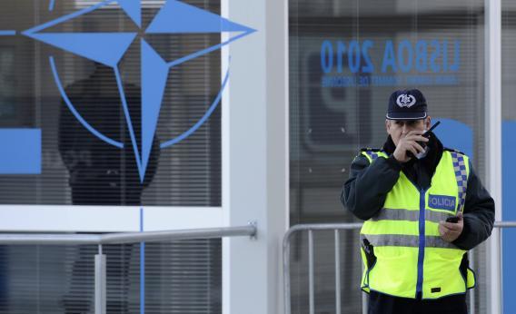 A policeman speaks on a walkie-talkie.