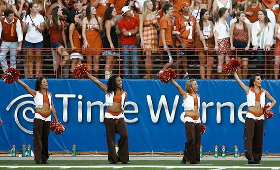 The University of Texas pom squad fires up the student cheering section during a Texas Longhorns football game.