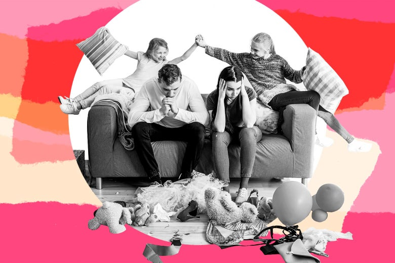 Stressed parents sitting on a couch in a messy living room as their kids play above them