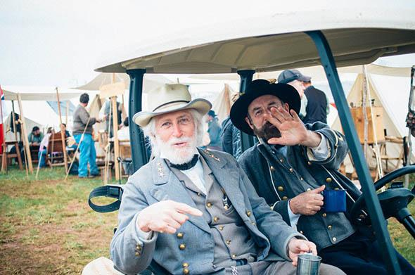 The Robert E. Lee re-enactor travels between tents at the main camp site in Appomattox, Virginia.