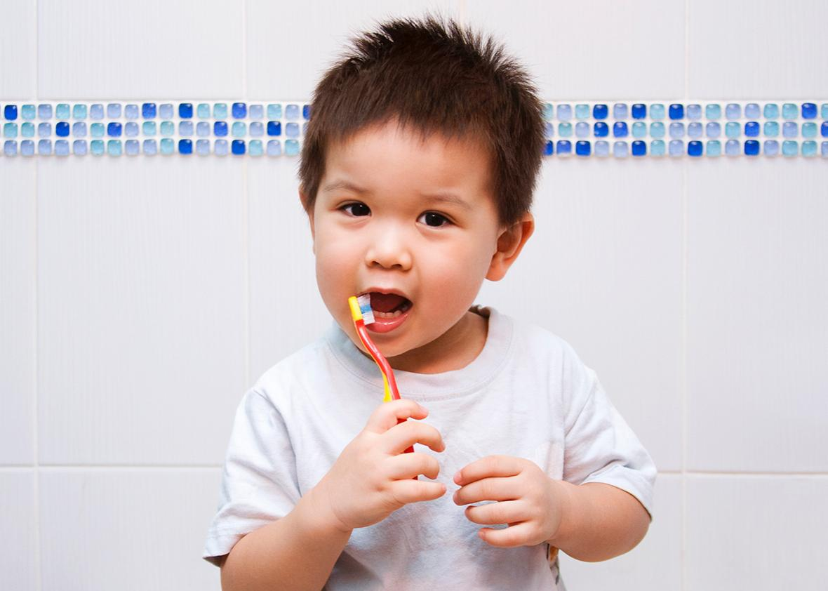 toddler brushing teeth.