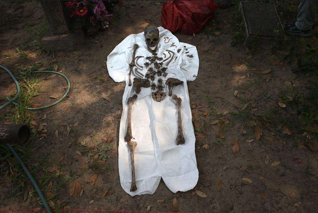 Falfurrias, Texas An unidentified immigrant's bones are reassembled after the remains were exhumed from a gravesite on May 22, 2013 in Falfurrias, Brooks County, Texas. In Brooks County alone, at least 129 immigrants perished in 2012, most of dehydration while making the long crossing from Mexico. Teams from Baylor University and the University of Indianapolis are exhuming the bodies of more than 50 immigrants who died, mostly from heat exhaustion, while crossing illegally from Mexico into the United States. The bodies will be examined and cross checked with DNA sent from Mexico and Central American countries, with the goal of reuniting the remains with families.