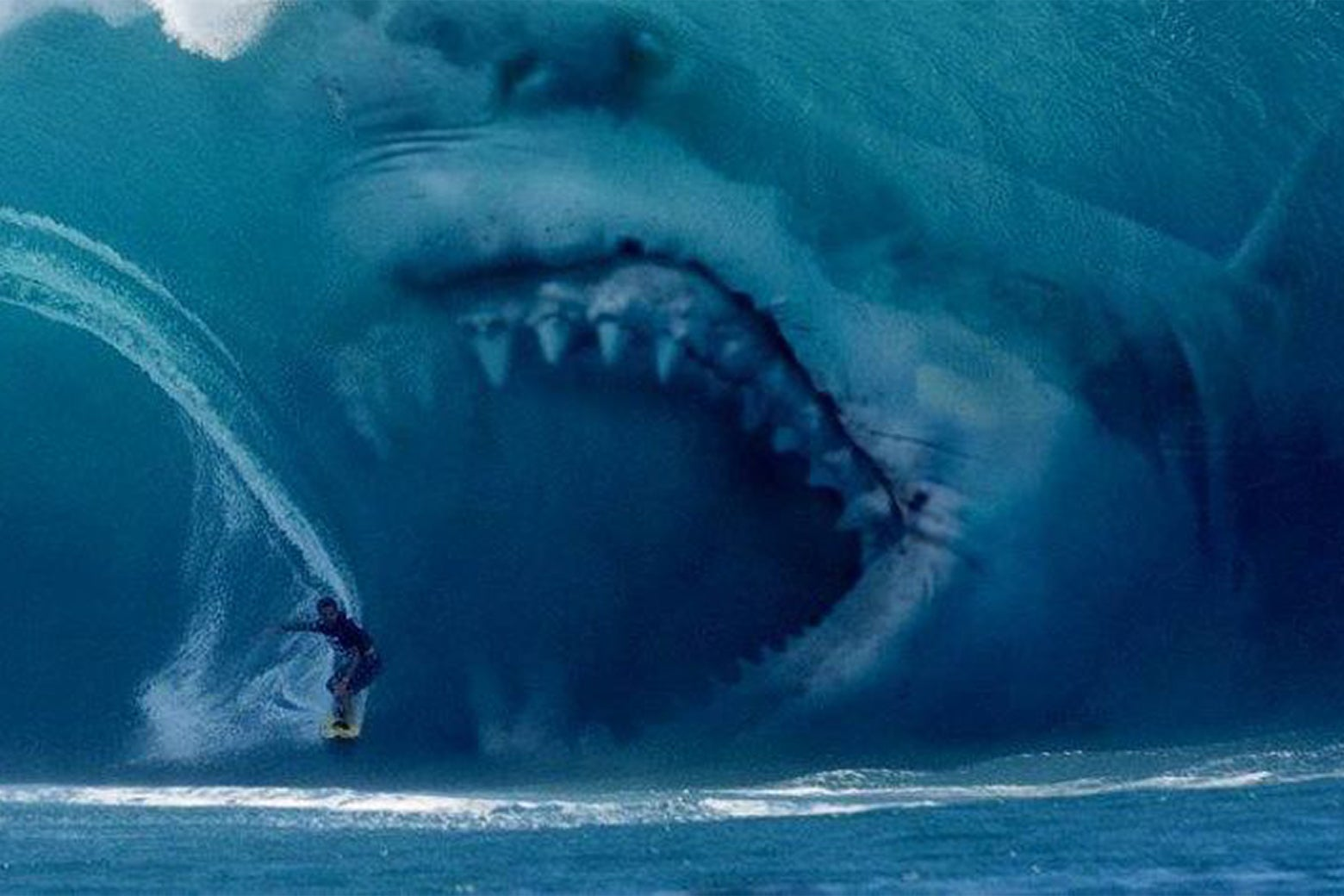 A giant shark eating a surfer in a still from The Meg.