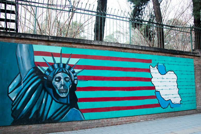 Anti-American mural depicts a skeletonized Statue of Liberty skeleton on the wall of the former U.S. Embassy in Tehran in December 2015.