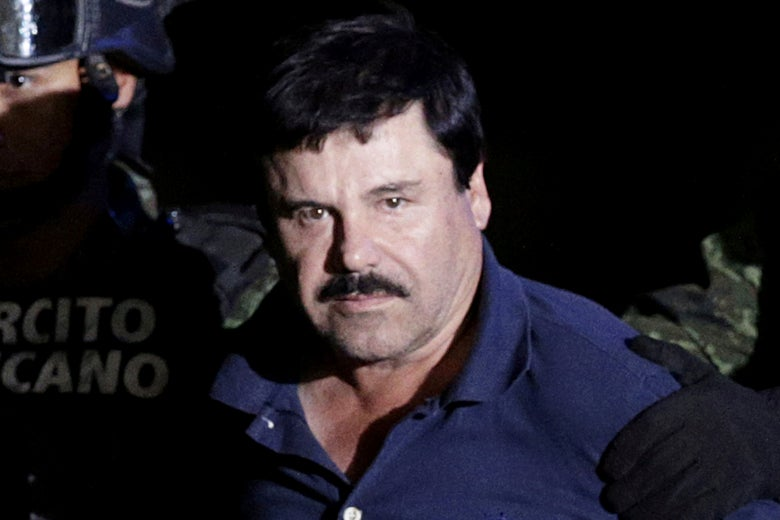 "Recaptured drug lord Joaquin ""El Chapo"" Guzmán is escorted by soldiers at the hangar belonging to the office of the Attorney General in Mexico City, Mexico, January 8, 2016."