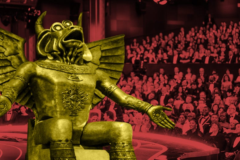 Moloch sits onstage at the Oscars.