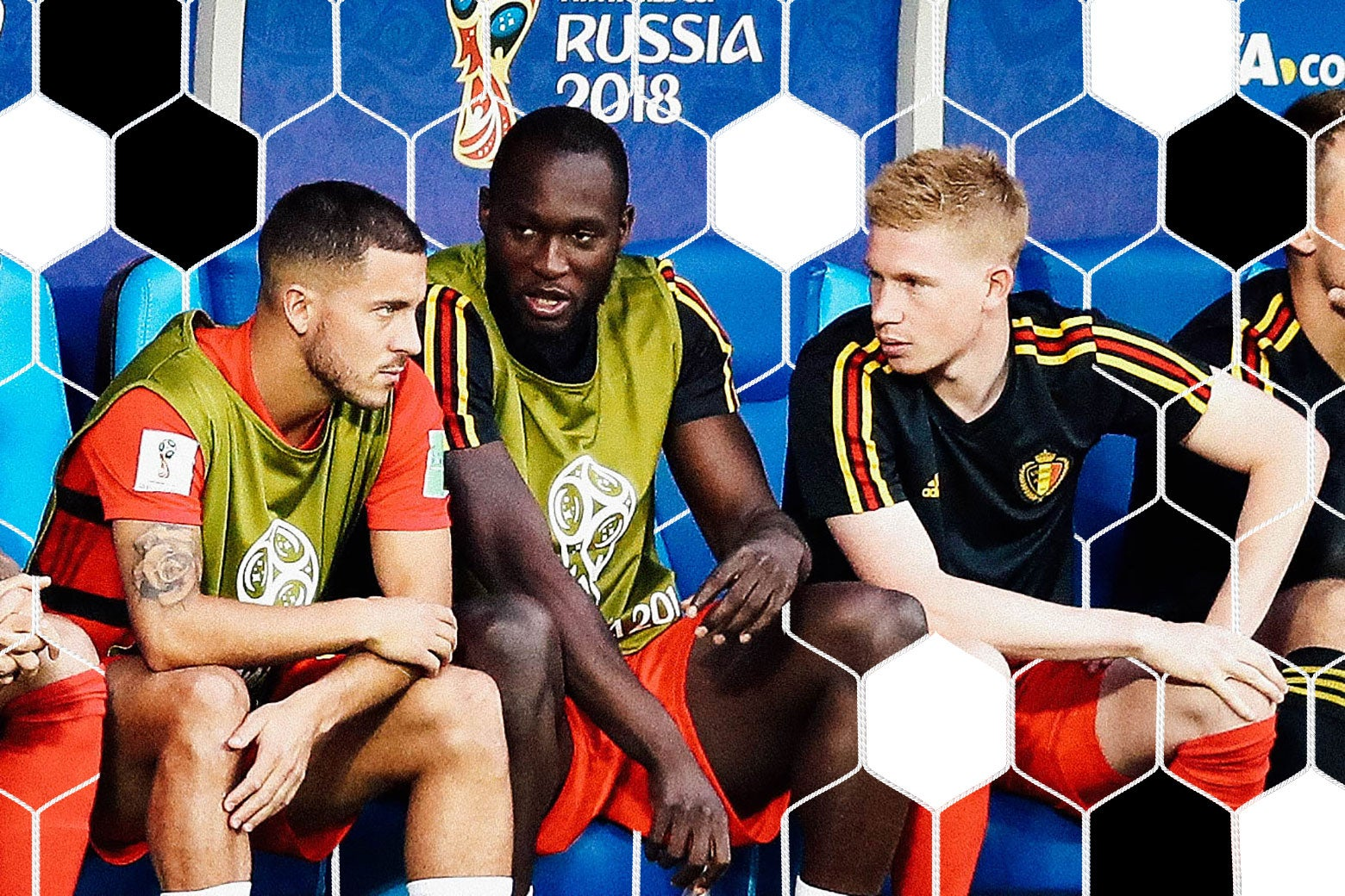 Eden Hazard of Belgium talks with teammates Romelu Lukaku and Kevin De Bruyne.