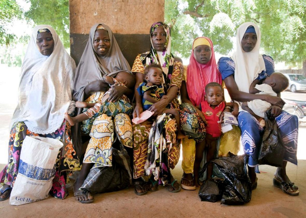 Children and mothers await care at a health post in the Kebbi st