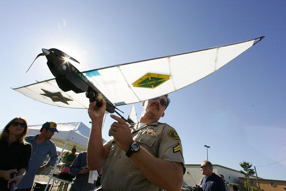 Deputy Troy Sella from the new technology department of the Los Angeles Sheriff's Department (LASD) prepares the SkySeer Unmanned Arial Vehicle (UAV) drone for launch,16 June 2006 during a demonstration flight in Redlands, California. The LASD plans to purchase SkySeer drones to carry out surveillance and rescue operations.