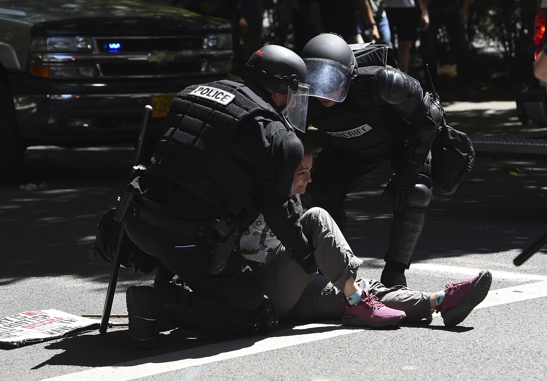 Portland Police handcuff a counterprotester.
