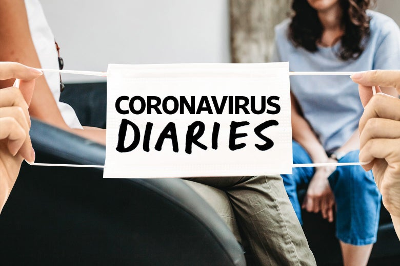 "Two women sit behind hands holding a surgical mask that says ""Coronavirus Diaries."""