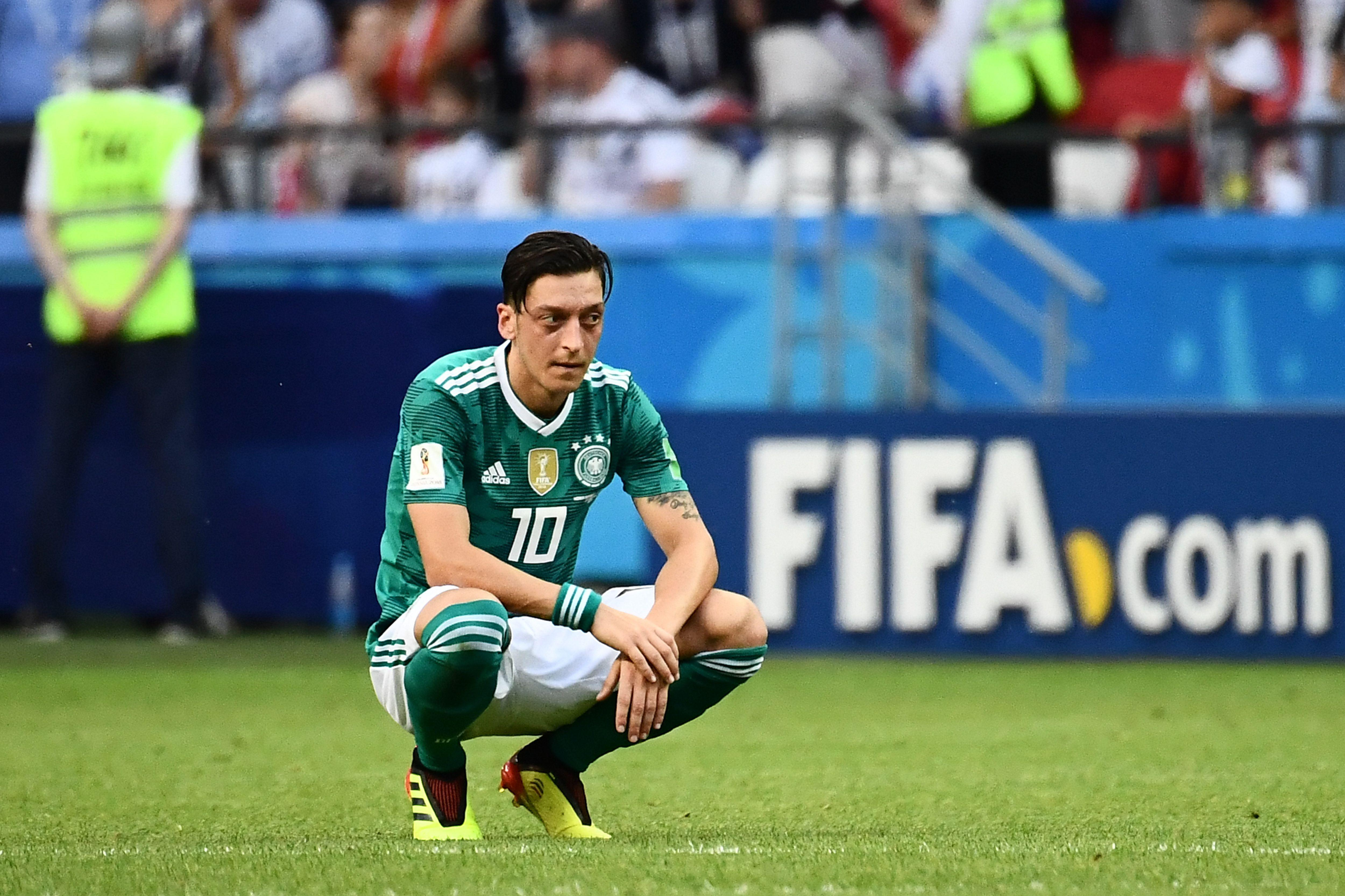 Germany's midfielder Mesut Ozil reacts after South Korea's forward Son Heung-min (unseen) scored the second goal during the Russia 2018 World Cup Group F football match between South Korea and Germany at the Kazan Arena in Kazan on June 27, 2018. (Photo by Jewel SAMAD / AFP) / RESTRICTED TO EDITORIAL USE - NO MOBILE PUSH ALERTS/DOWNLOADS        (Photo credit should read JEWEL SAMAD/AFP/Getty Images)
