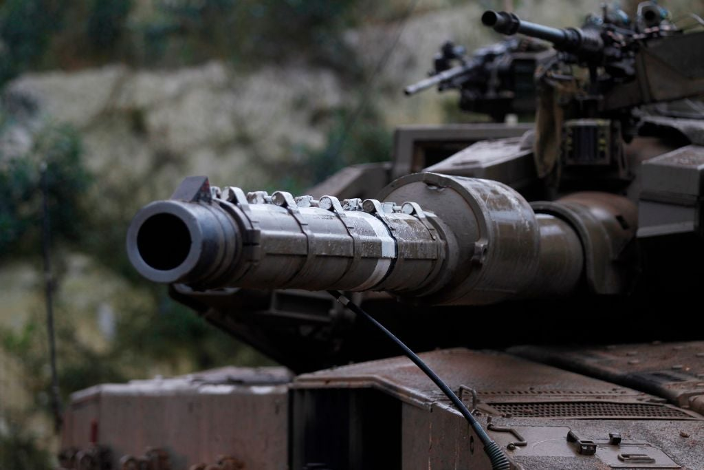 The cannon of an Israeli tank points toward the camera.