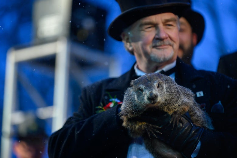 Groundhog handler John Griffiths holds Punxsutawney Phil, who did not see his shadow, predicting an early or late spring during the 134th annual Groundhog Day festivities on February 2, 2020 in Punxsutawney, Pennsylvania.