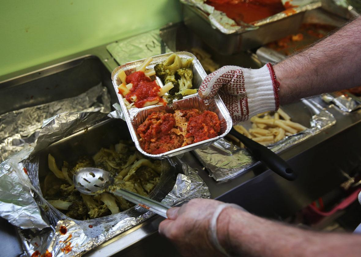 A Catholic Services worker prepares 'meals on wheels' lunch delivery on March 12, 2014 in Franklin, New Jersey.