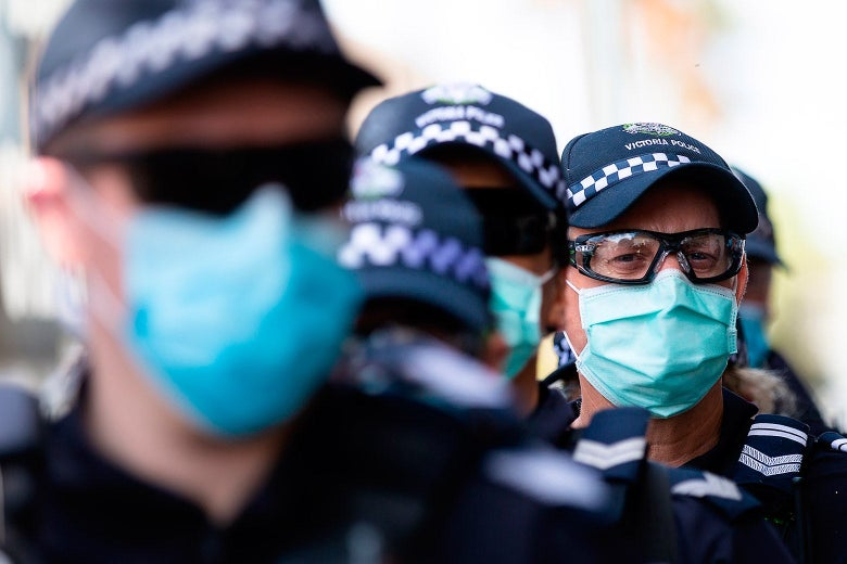 Men wearing caps, goggles, and masks