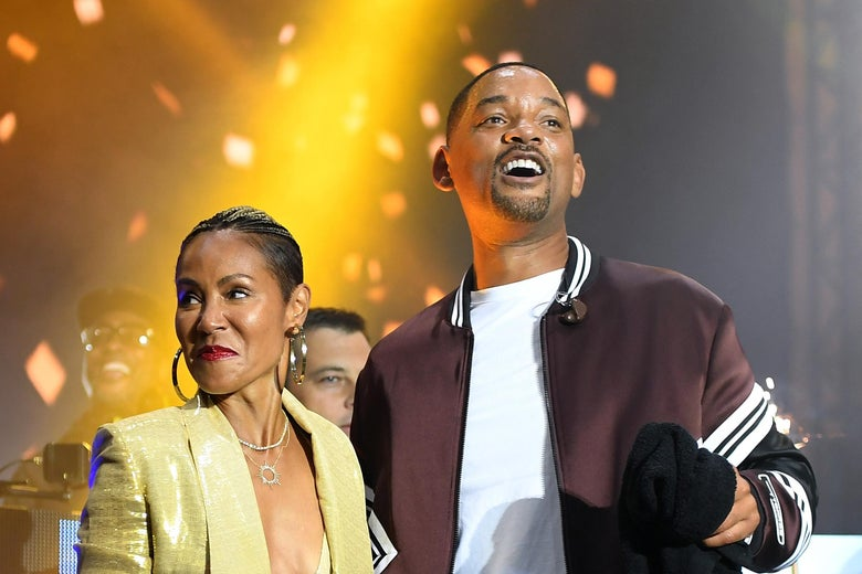 Will Smith and wife Jada Pinkett Smith, looking triumphant.