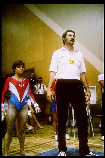 Mary Lou Retton of the United States (left) stands with her coach Bela Karolyi.