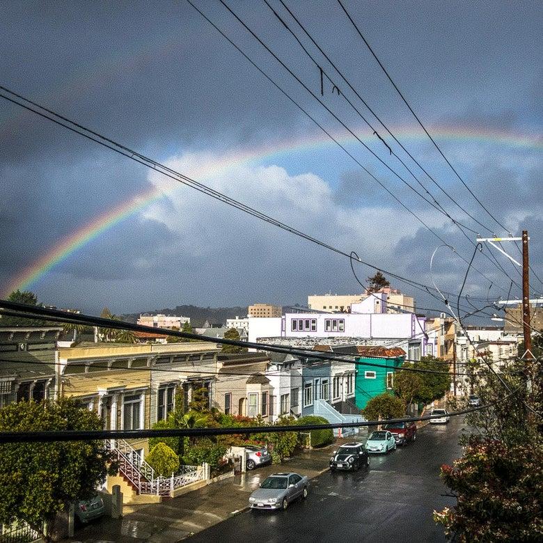A rainbow over a wet street