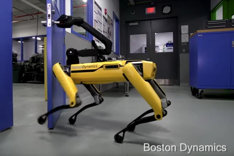 """A robot """"dog"""" seen opening a door."""