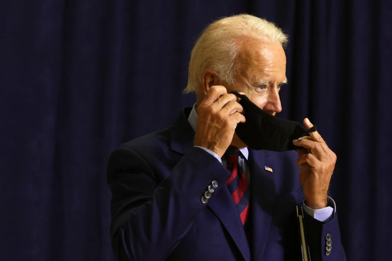 Democratic presidential nominee Joe Biden puts on his mask after speaking at a campaign event September 4, 2020 in Wilmington, Delaware.