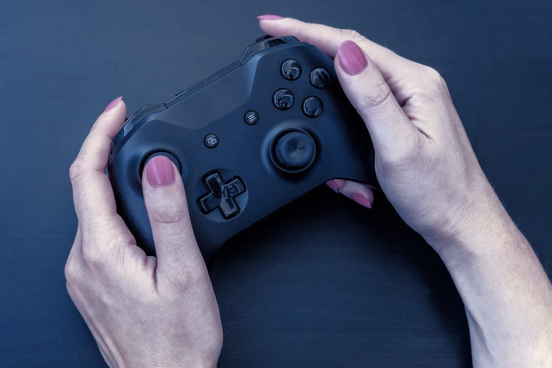 A woman holding a video game controller.