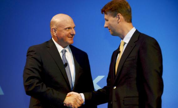 Microsoft CEO Steve Ballmer shakes hands with Nokia chairman Risto Siilasmaa after Nokia announced the sale of its mobile phone unit to Microsoft for $7.2 billion, bringing to an end its days as a phone maker.
