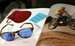 Late US movie star Steve McQueen's Persol sunglasses on display.