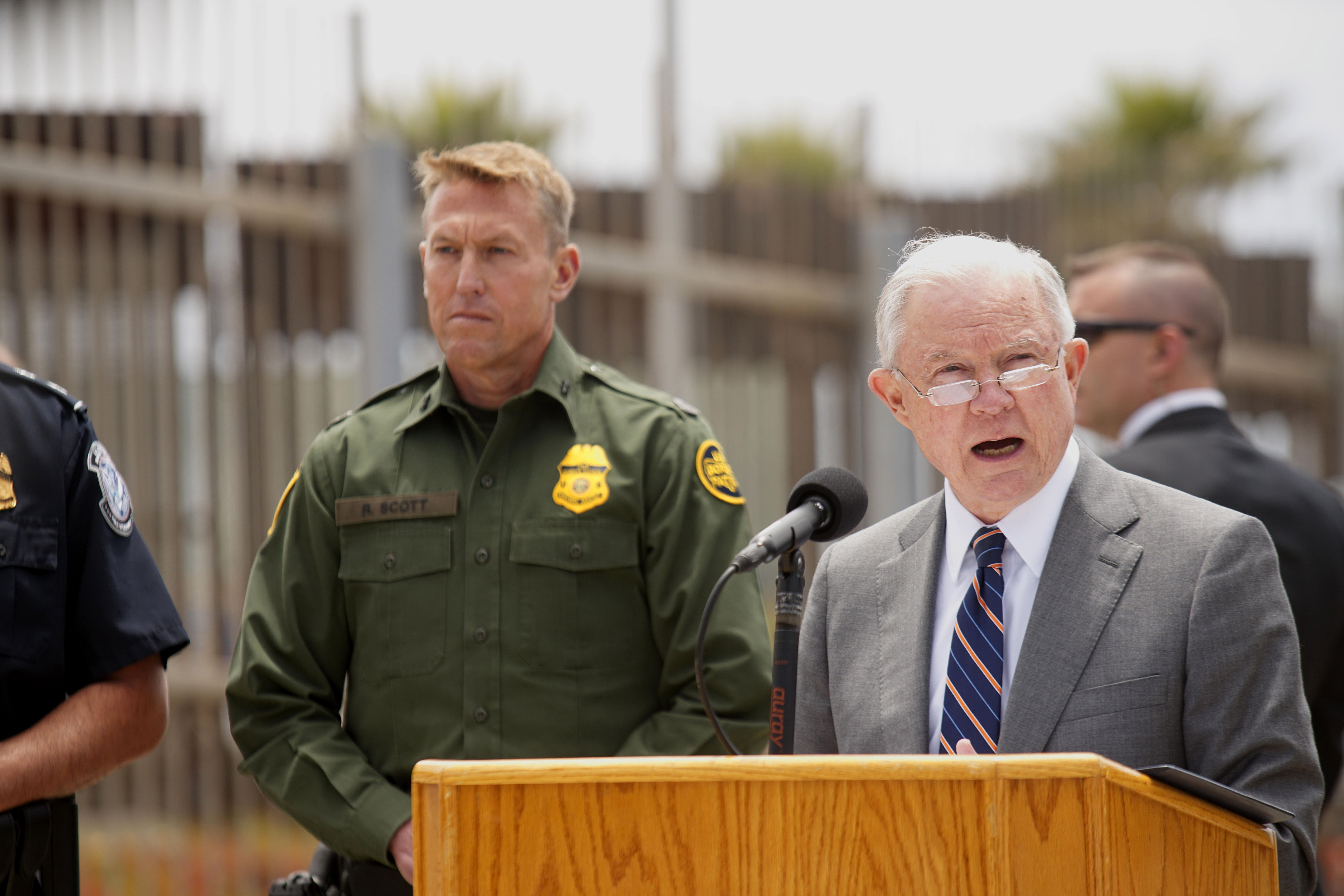 Attorney General Jeff Sessions speaks from a podium at the border.
