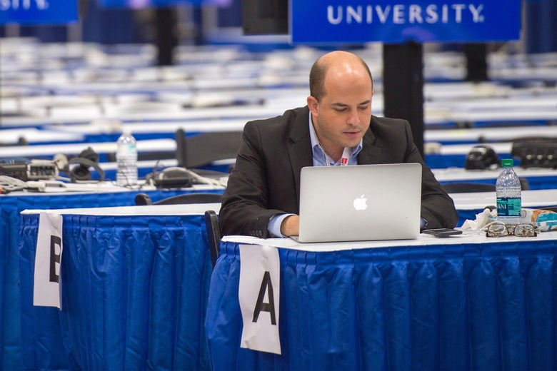 Brian Stelter works in a nearly empty media filing center on September 24, 2014, at Hofstra University in Hempstead, New York.