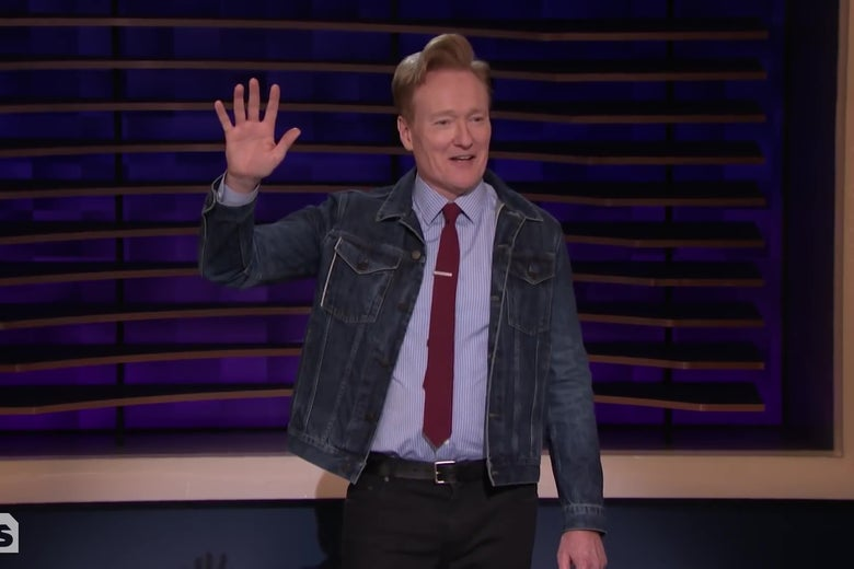 Conan O'Brian, raising his hand.