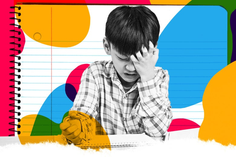 A boy scratches his head as he gets irritated doing his homework.