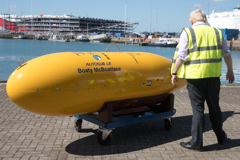 A yellow submarine sits on a dolly, with the name Boaty McBoatface emblazoned on the side.