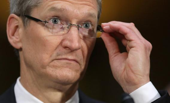 Tim Cook, seen here fiddling with his glasses, thinks most people would prefer to avoid fiddling with their glasses.