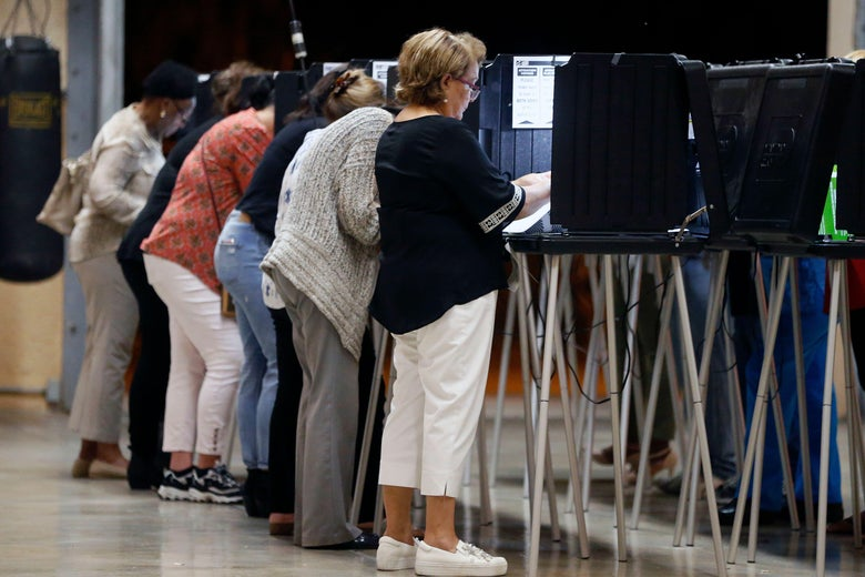People vote at a polling station in Miami, Florida, on November 6, 2018. - Americans vote today in critical midterm elections that mark the first major voter test of Donald Trump's presidency, with control of Congress at stake. (Photo by RHONA WISE / AFP)        (Photo credit should read RHONA WISE/AFP/Getty Images)