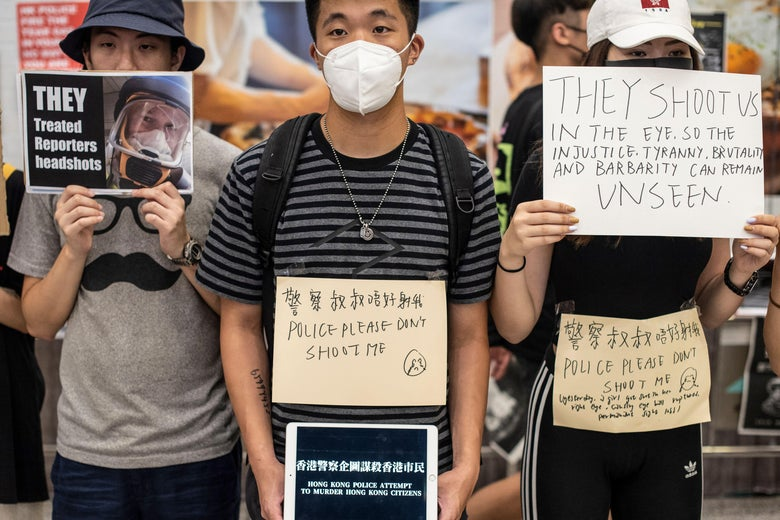 Protesters hold placards at Hong Kong's international airport.