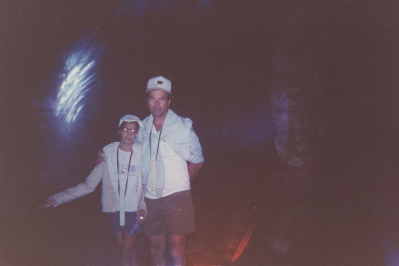 Kerri Rawson and her father in a dark space with a spectral burst of light hovering next to their heads.