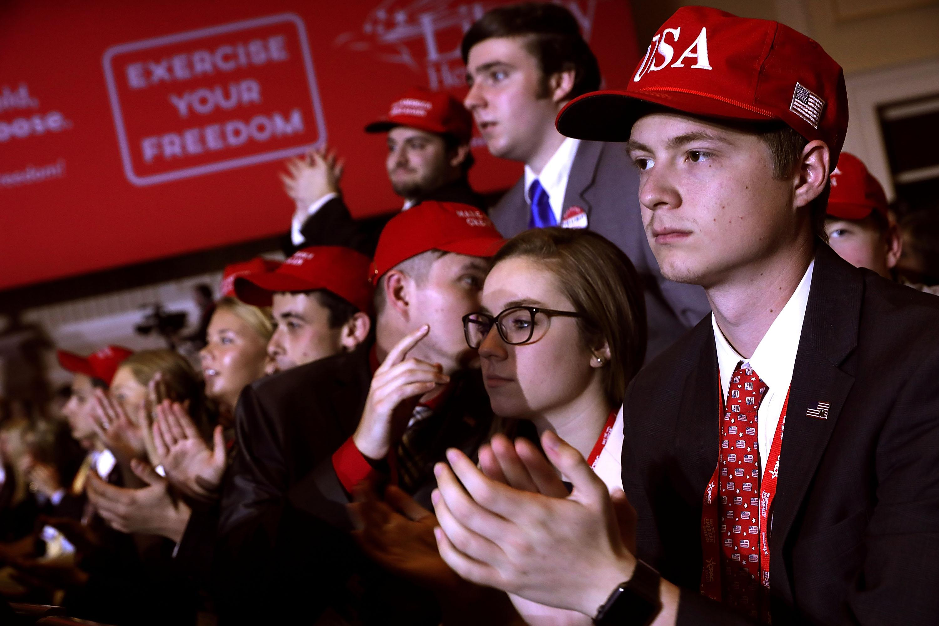 Young supporters cheer as President Donald Trump addresses CPAC.