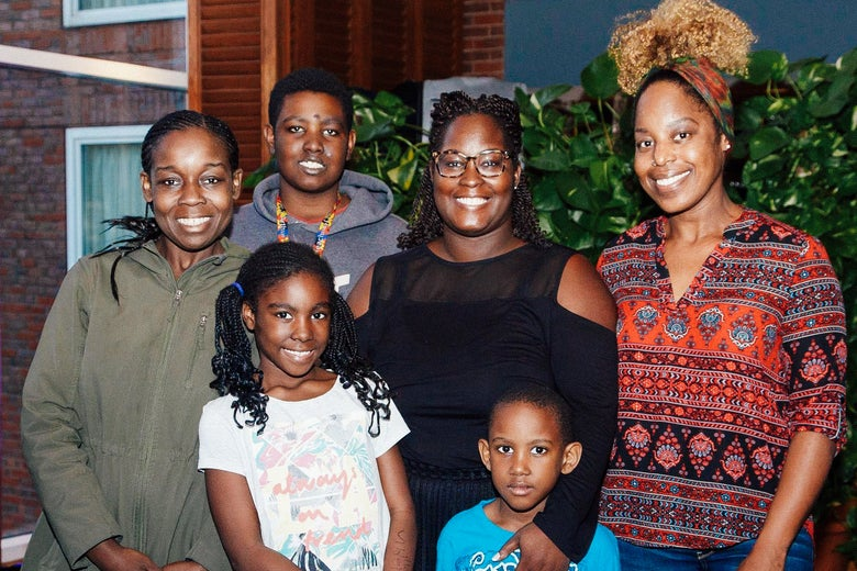 Gardite Fougy is pictured at center with her sister Stephanie Fougy (far left) and friend Aisha Baker (far right), and Fougy's three children: Myien, 14, Myiella, 9, and Gabriel, 6.