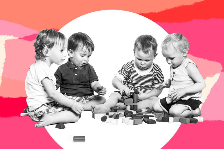 A group of white toddlers playing with blocks.